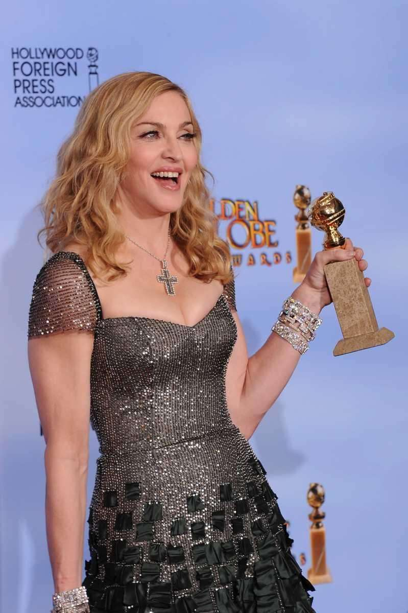 Madonna poses with the trophy at the 69th