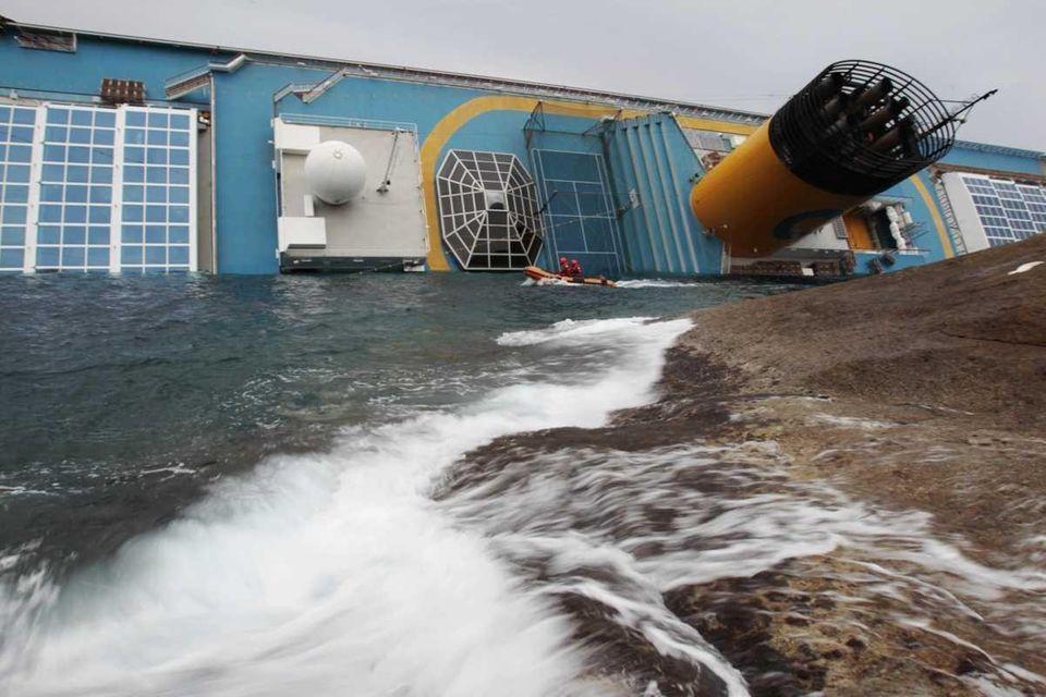 Italian rescue divers approach the Costa Concordia cruise