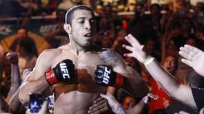 Featherweight champion Jose Aldo, from Brazil, celebrates with
