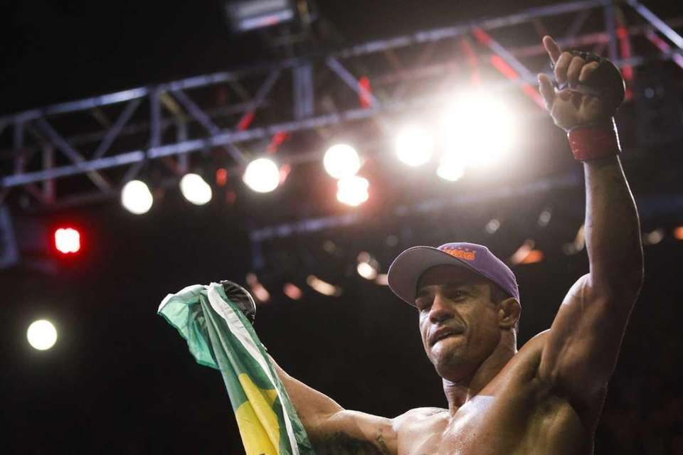 Vitor Belfort, from Brazil, celebrates after defeating Antony