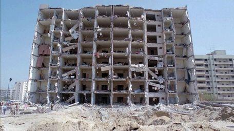 Saudi Arabia's Khobar Towers smolders after it was