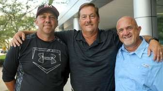 Newsday sports writer Gregg Sarra, center, poses with