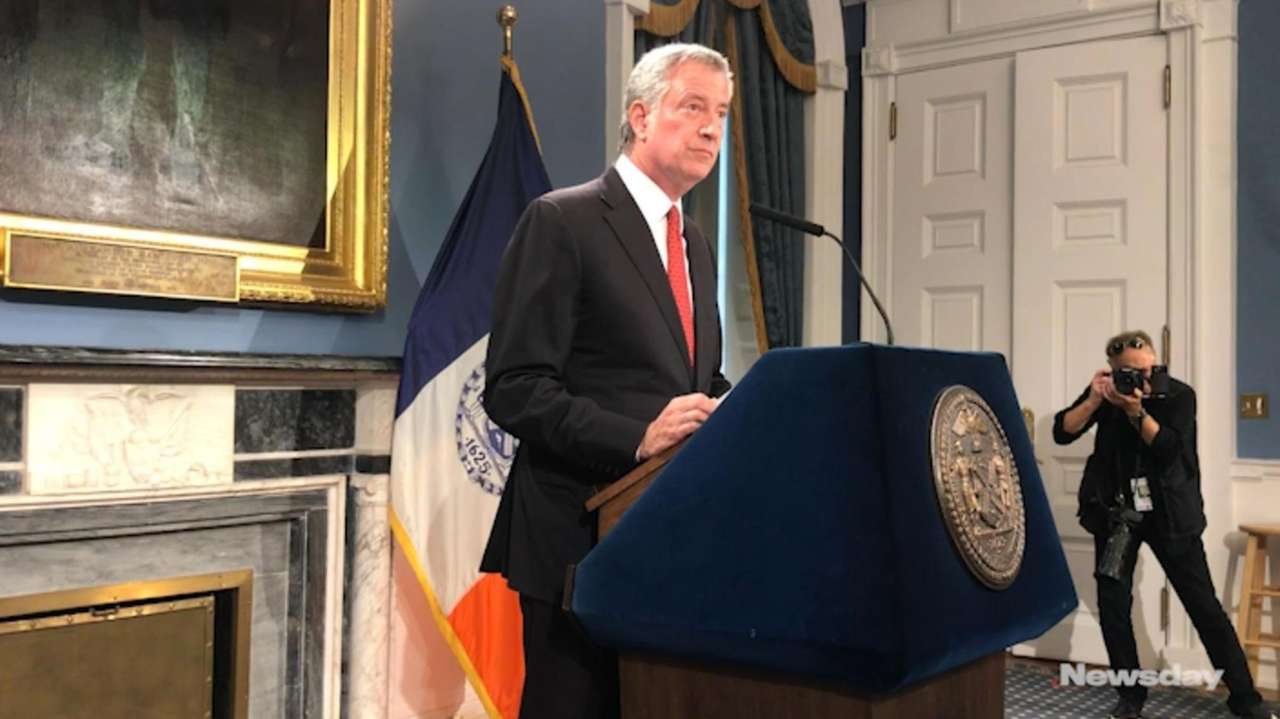 Mayor Bill de Blasio addresses the media Friday