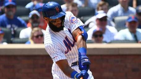 New York Mets shortstop Amed Rosario hits an