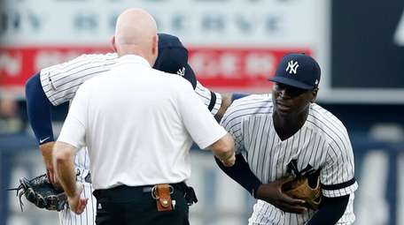 Trainer Steve Donohue checks on Didi Gregorius during