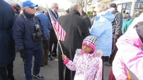 Varicaka Wilson, 7, of Long Beach, participates in
