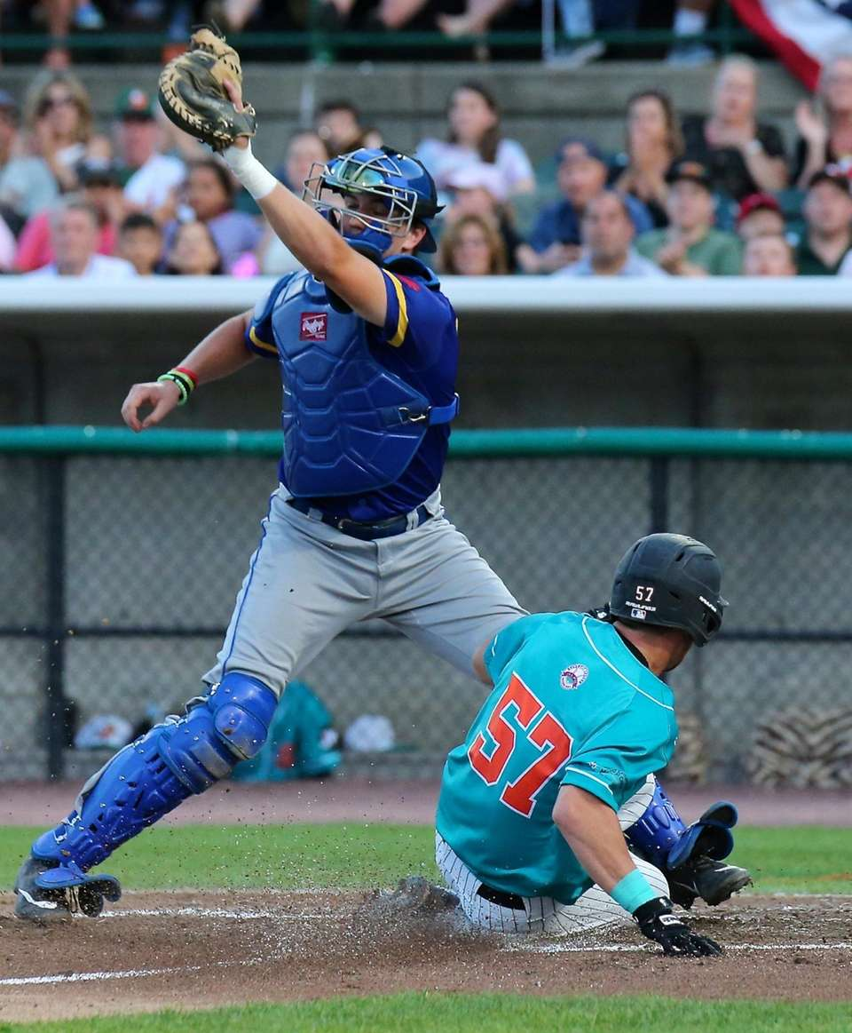 Long Island Ducks Nick Garland slides safely into