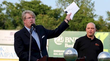 Long Island Ducks founder Frank Boulton holds up