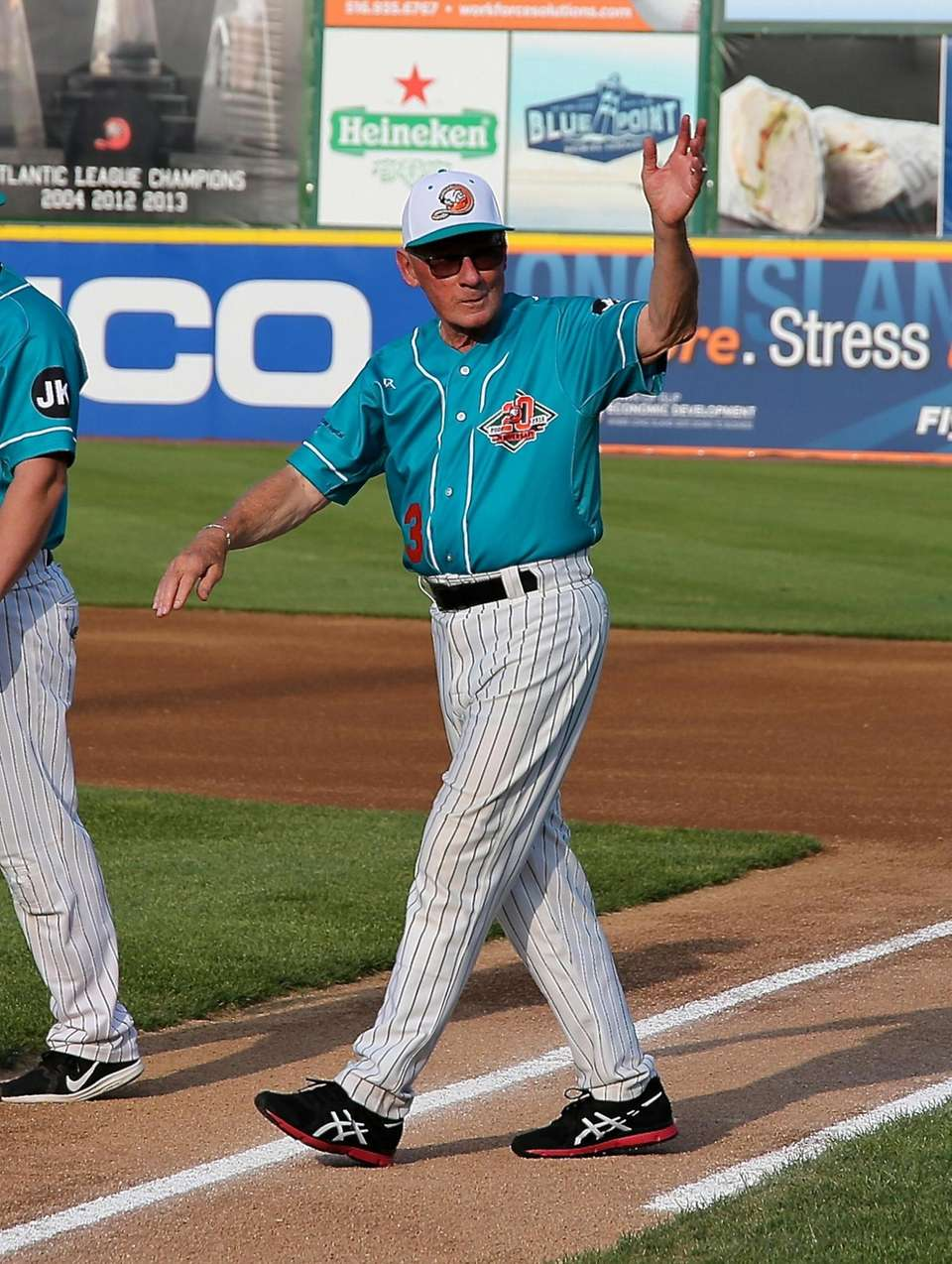 Long Island Ducks Bud Harrelson walks onto the