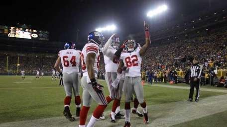 Mario Manningham #82 of the Giants celebrates touchdown