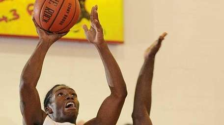 Stony Brook guard Dave Coley rebounds and shoots