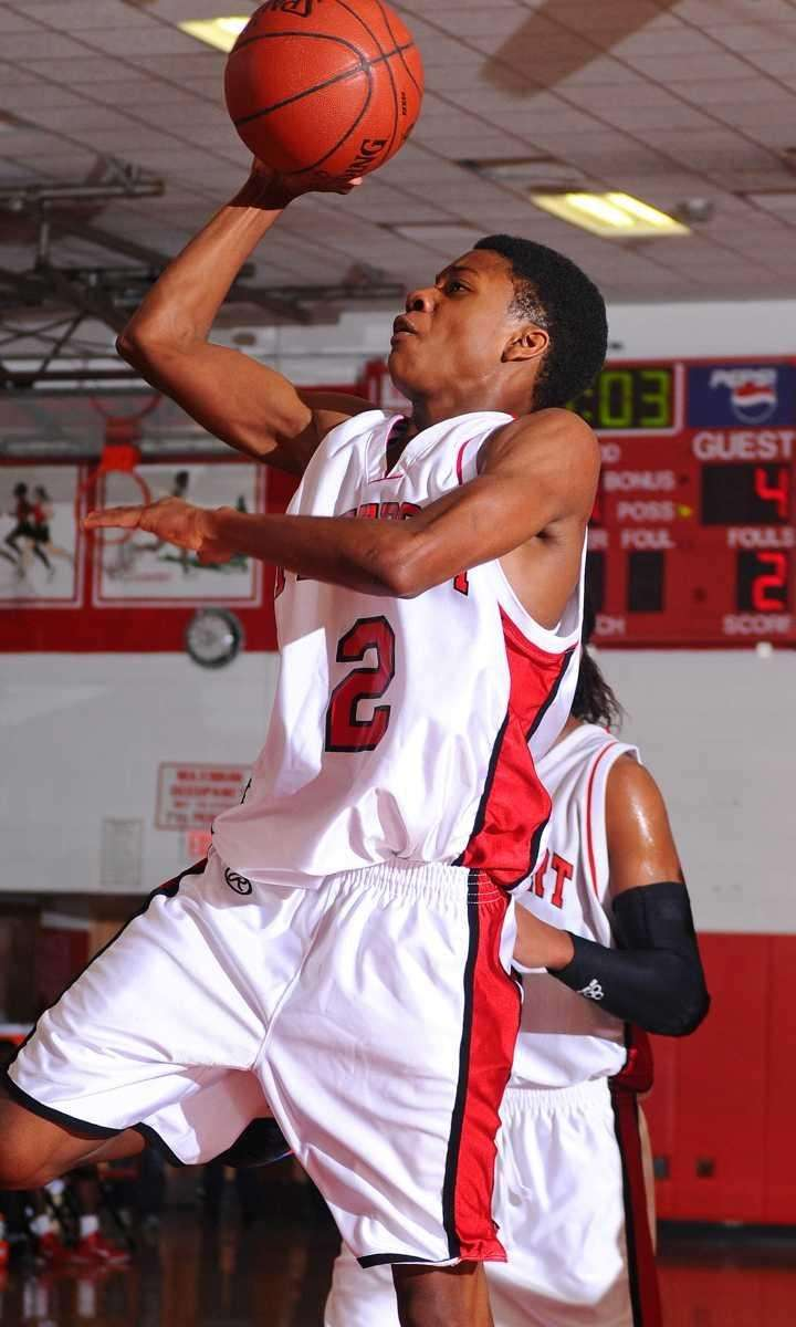 Kahiem Chaplin drives to the basket in the