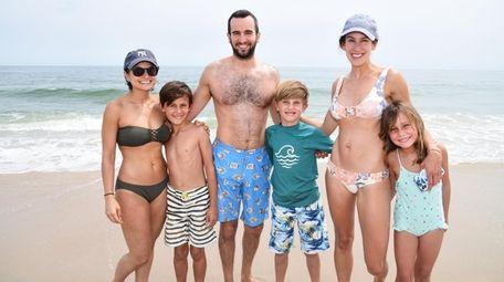 Sarie Weiss, left, Dylan Goldstein, 8, Matt Greenberg,