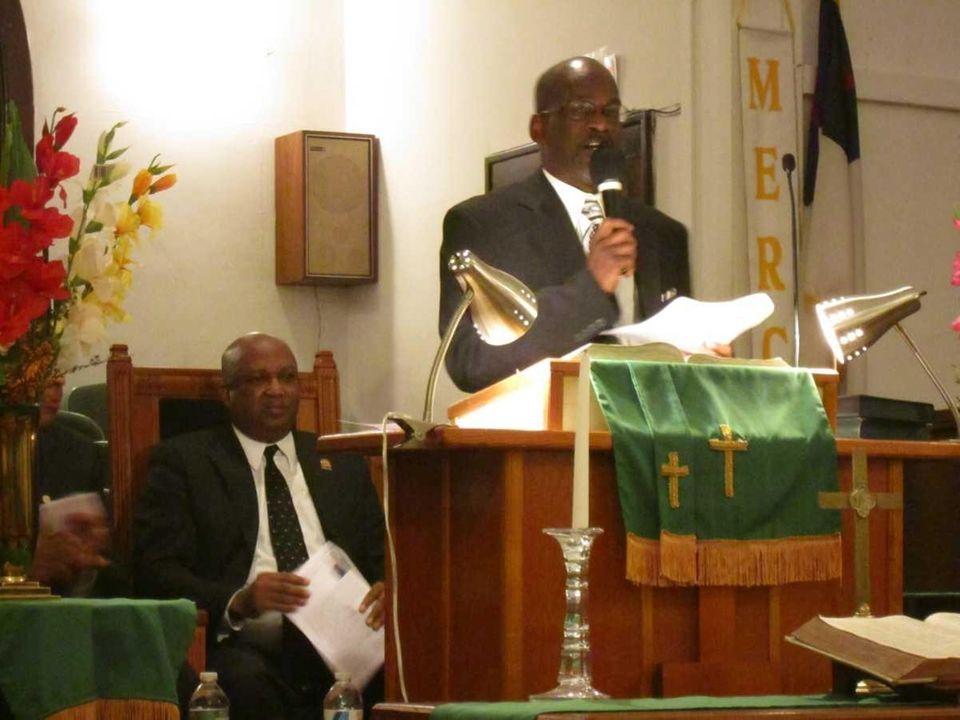 The Rev. Larry Jennings, right, pastor of Bethel