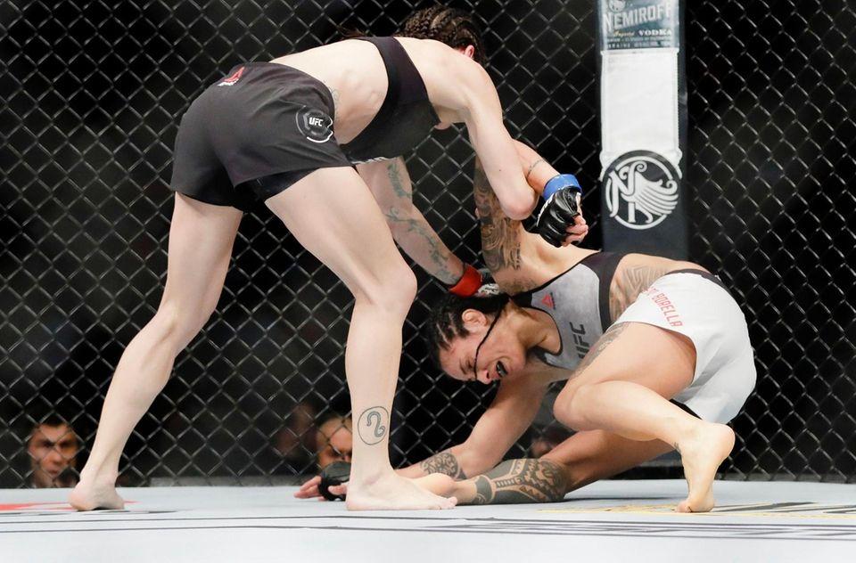 Lauren Murphy, left, knocks down Italy's Mara Romero