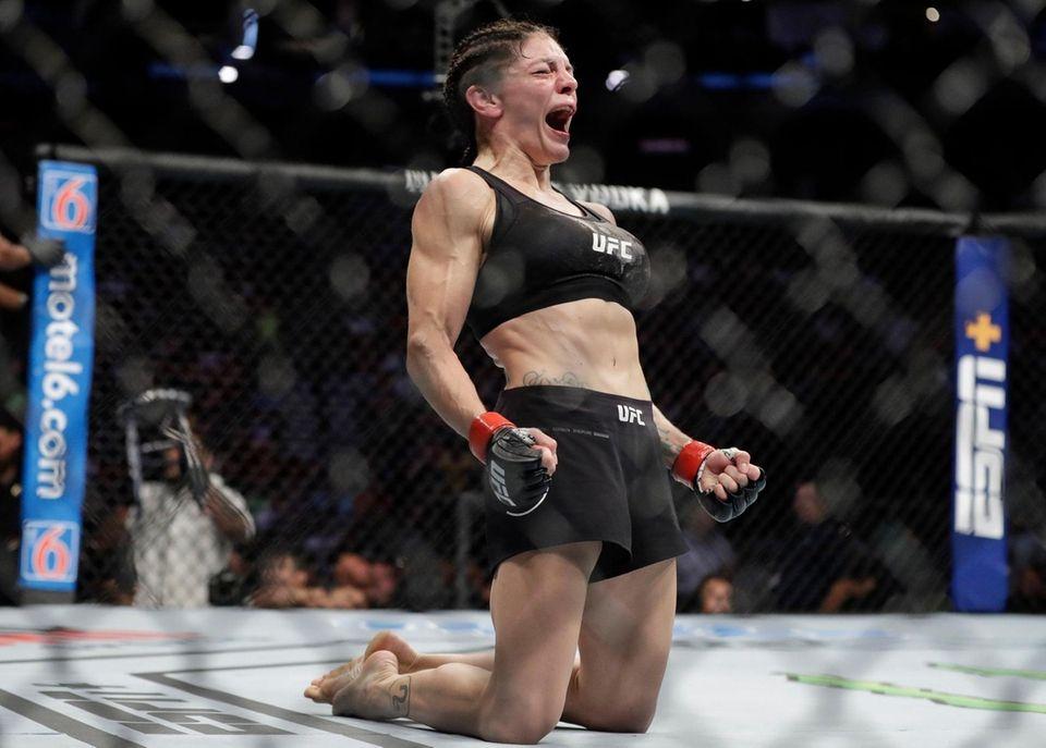Lauren Murphy celebrates after a women's flyweight mixed