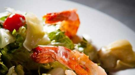 Grilled shrimp and artichokes topped with Parmesan cheese