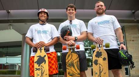 Skateboarders Devin Votta, left, and brothers James and