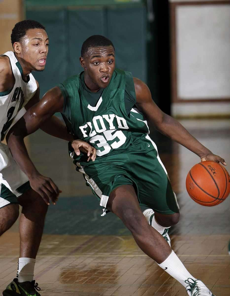 Floyd's Anthony White drives against Brentwood's Joshua Crooms