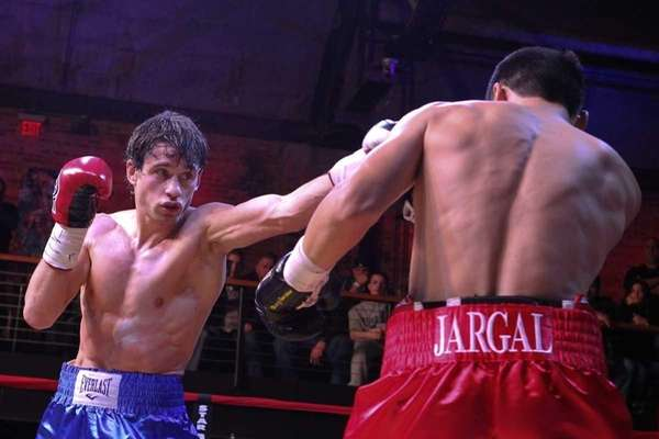 Chris Algieri, left, fights at the Paramount in