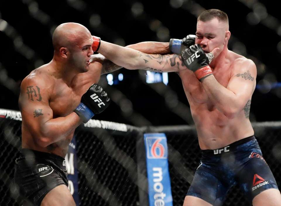 Robbie Lawler, left, punches Colby Covington during the