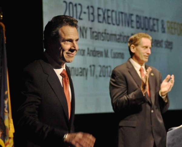 New York State Gov. Andrew Cuomo, left, prepares