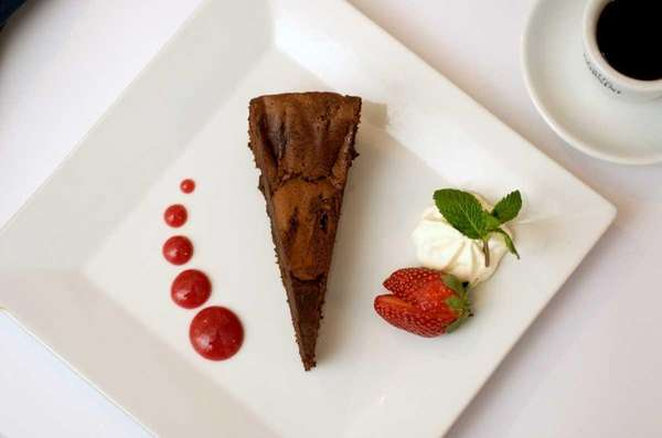 Flourless chocolate cake is offered on the dessert