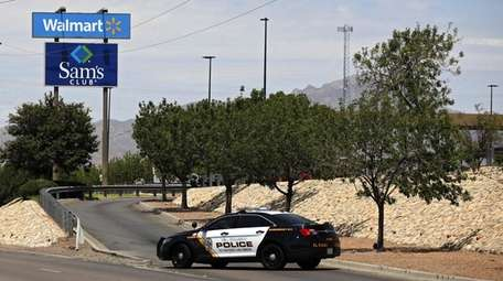 Police block a roadway after the mass shooting