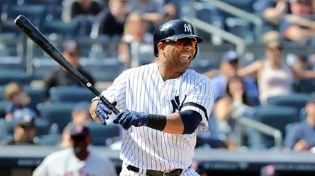 Edwin Encarnacion #30 of the Yankees reacts after