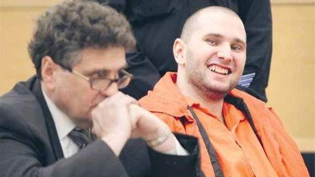 Maksim Gelman, right, laughs during his sentencing at