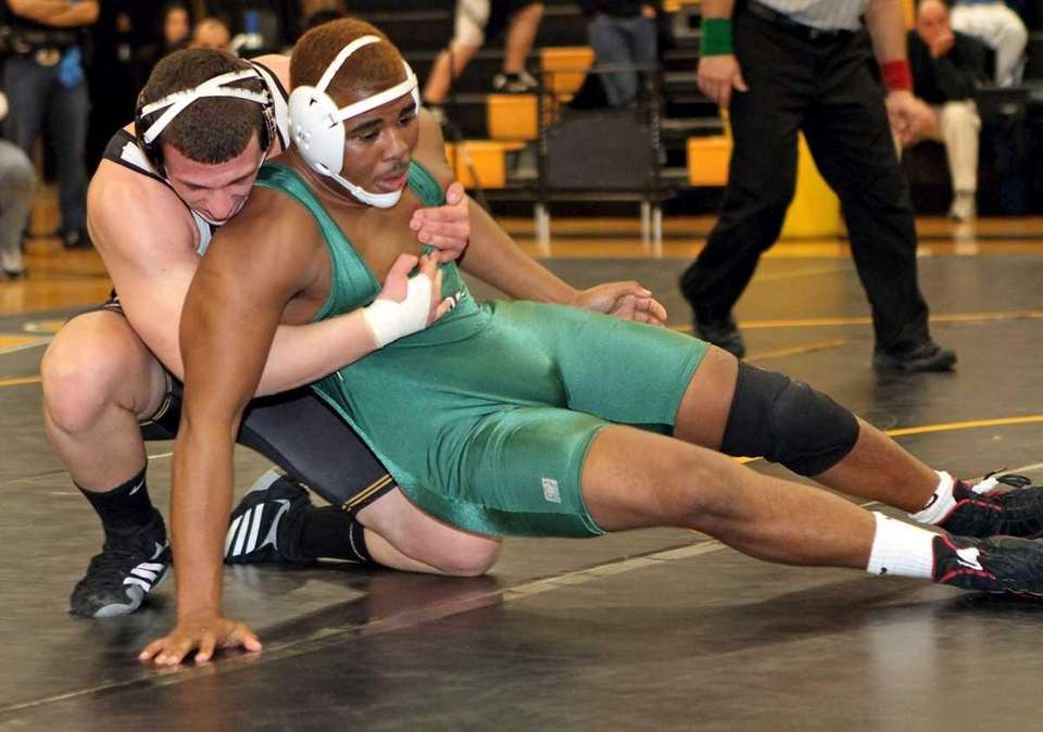 Brentwood's Joshua Barksdale gets rolled over by Sachem