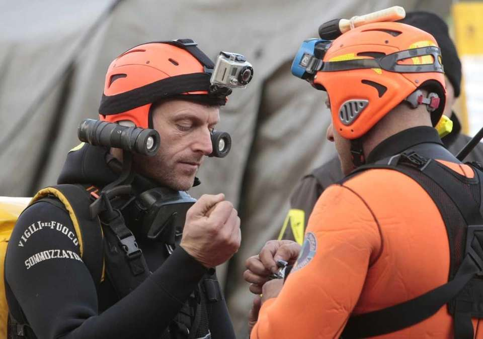 Italian divers chat as they prepare to head