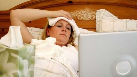 A file photo of a woman sick in