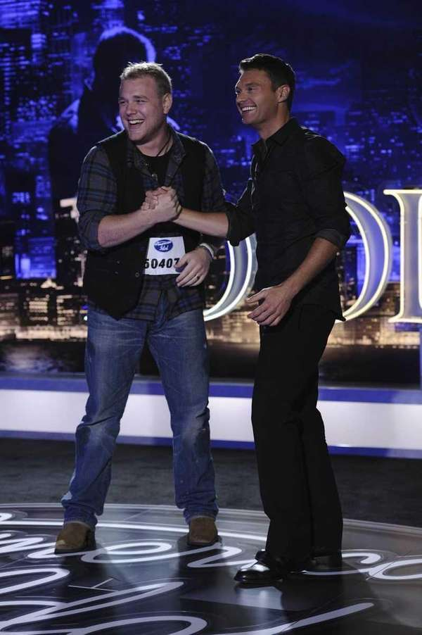 """American Idol"" contestant W.T. Thompson is greeted by"