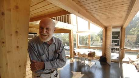 Photographs of architect Andrew Geller, of Northport, visiting