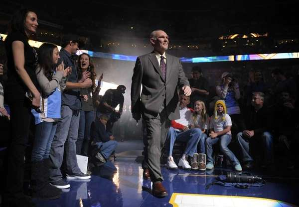 Denver Nuggets head coach George Karl walks onto