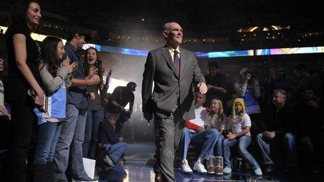 Denver Nuggets head coach George Karl walks onto