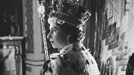 Queen Elizabeth II poses in her coronation attire