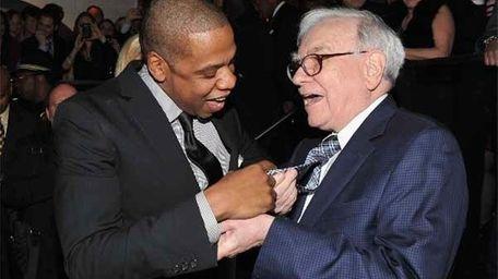 Jay-Z and Warren Buffett attend the grand re-opening