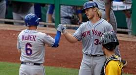 The Mets' Jeff McNeil is greeted by starting