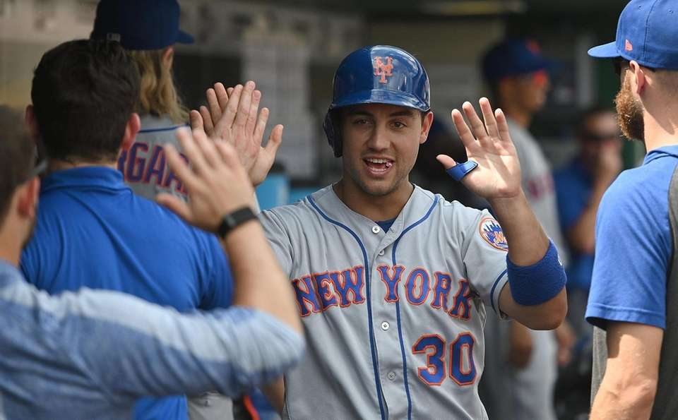 Mets outfielder Michael Conforto celebrates with teammates in