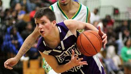 Port Jefferson forward Mateo Cello (22) drives past