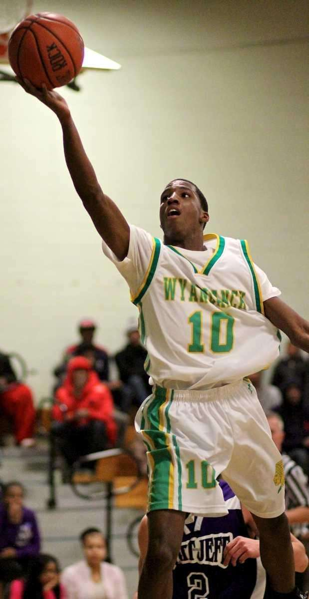 Wyandanch guard Damion Daniels (10) rolls in the