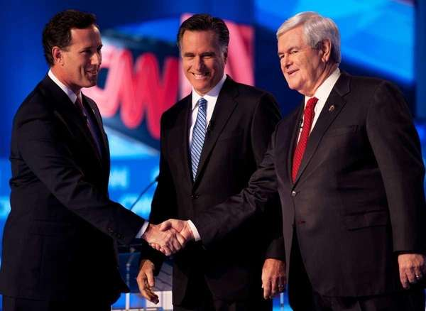 Republican presidential hopefuls former senator Rick Santorum (L),