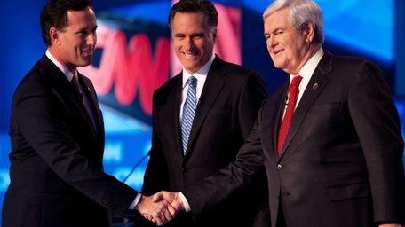 Republican presidential hopefuls former senator Rick Santorum (L),
