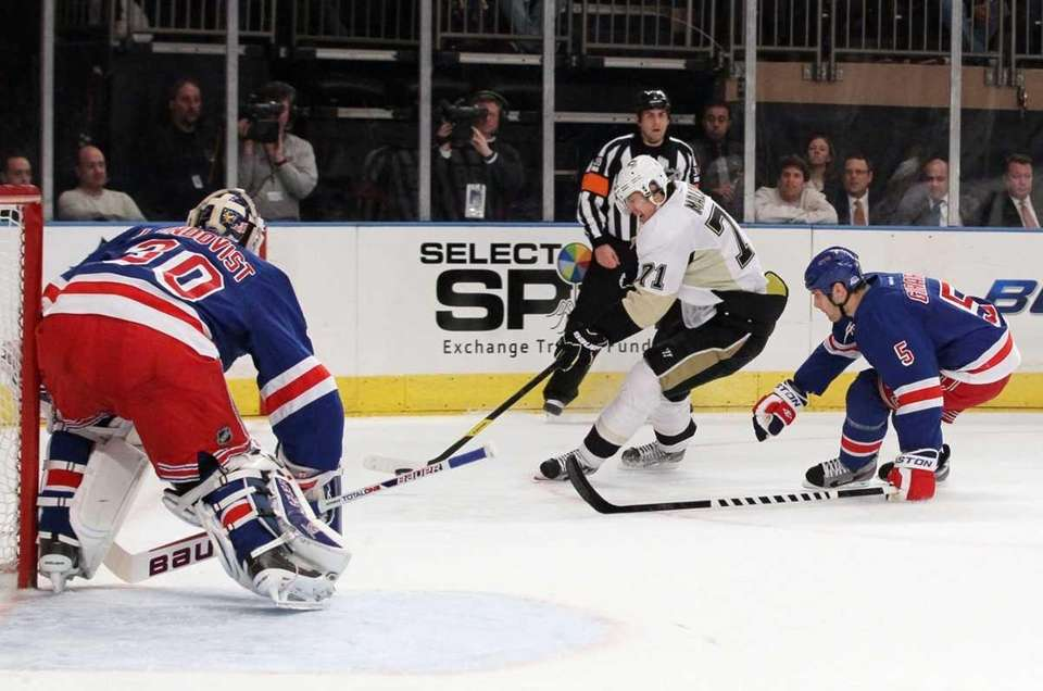 Henrik Lundqvist #30 and Dan Girardi #5 of