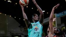 Liberty center Tina Charles shoots the ball against