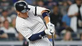 Yankees designated hitter Aaron Judge hits a solo