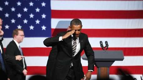 President Barack Obama salutes after speaking during a