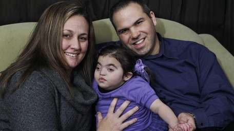 Chrissy and Joseph Rivera with their three-year-old daughter